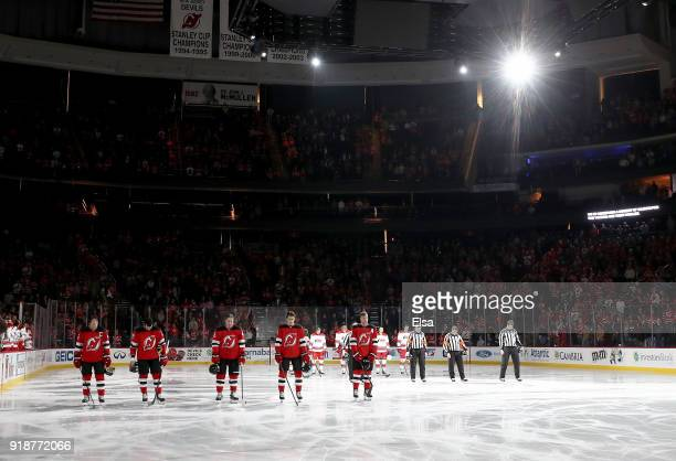 The New Jersey Devils and the Carolina Hurricanes stand for a moment of silence before the game to remember those students killed in the Majory...