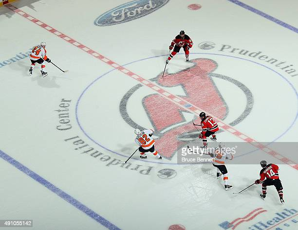 The New Jersey Devils and the Philadelphia Flyers play 3 on 3 in overtime at the Prudential Center on October 2, 2015 in Newark, New Jersey. The...