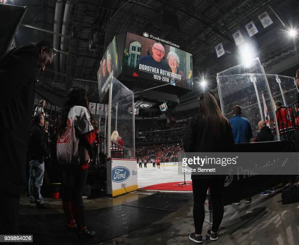 The New Jersey Devils and the Pittsburgh Penguins hold a moment of silence for Dorothea Rutherford the wife of the Penguins GM Jim Rutherford at the...