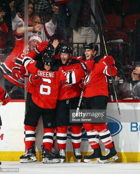 The New Jersey Devils celebrate a goal by Stefan Noesen at 1553 of the third period against the Anaheim Ducks at the Prudential Center on December 18...