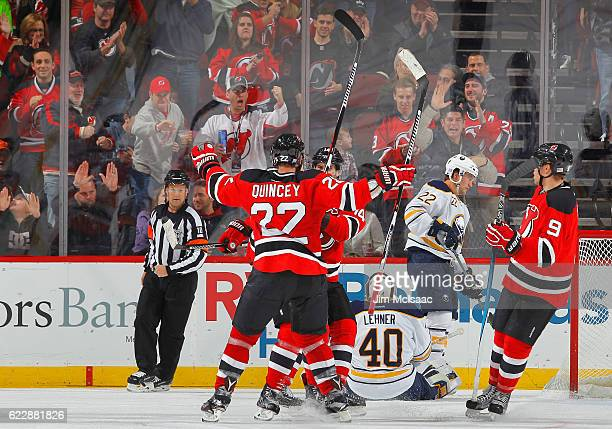 The New Jersey Devils celebrate a third period goal against the Buffalo Sabres scored by John Moore at the Prudential Center on November 12 2016 in...