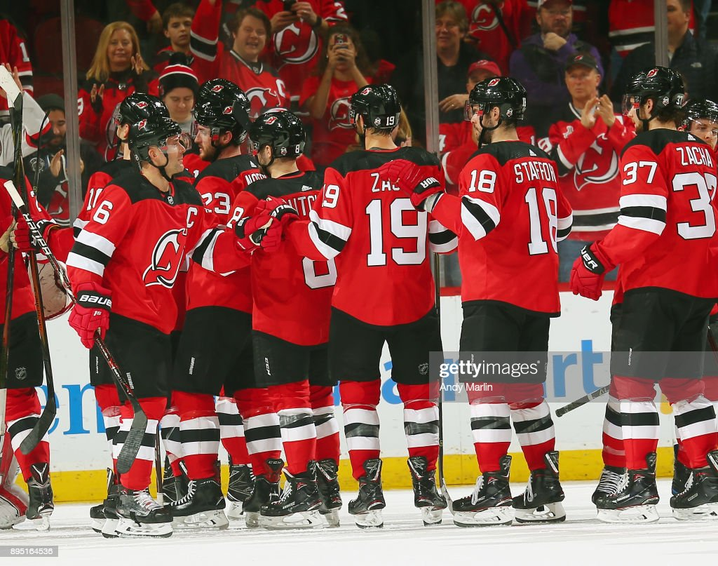 The New Jersey Devils celebrate after defeating the Anaheim Ducks 5-3 at Prudential Center on December 18, 2017 in Newark, New Jersey.