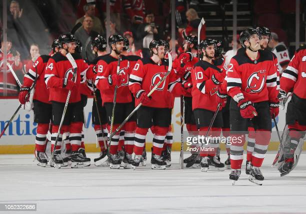The New Jersey Devils celebrate after defeating the Dallas Stars at Prudential Center on October 16 2018 in Newark New Jersey