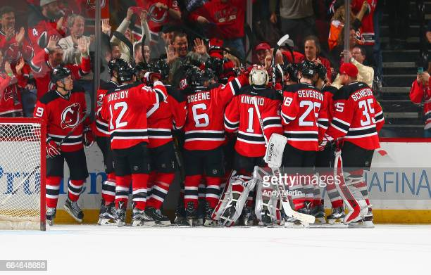 The New Jersey Devils celebrate after defeating the Philadelphia Flyers 10 in overtime at Prudential Center on April 4 2017 in Newark New Jersey