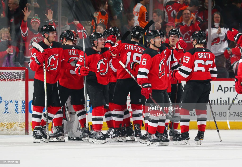 The New Jersey Devils celebrate after defeating the Philadelphia Flyers at Prudential Center on February 1, 2018 in Newark, New Jersey. The Devils defeated the Flyers 4-3.