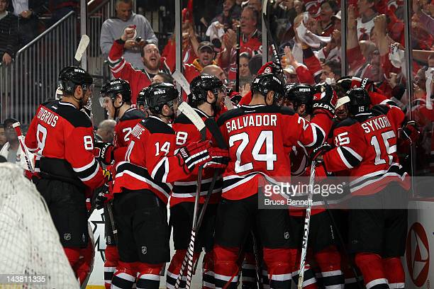 The New Jersey Devils celebrate after defeating the Philadelphia Flyers in over time of Game Three of the Eastern Conference Semifinals during the...