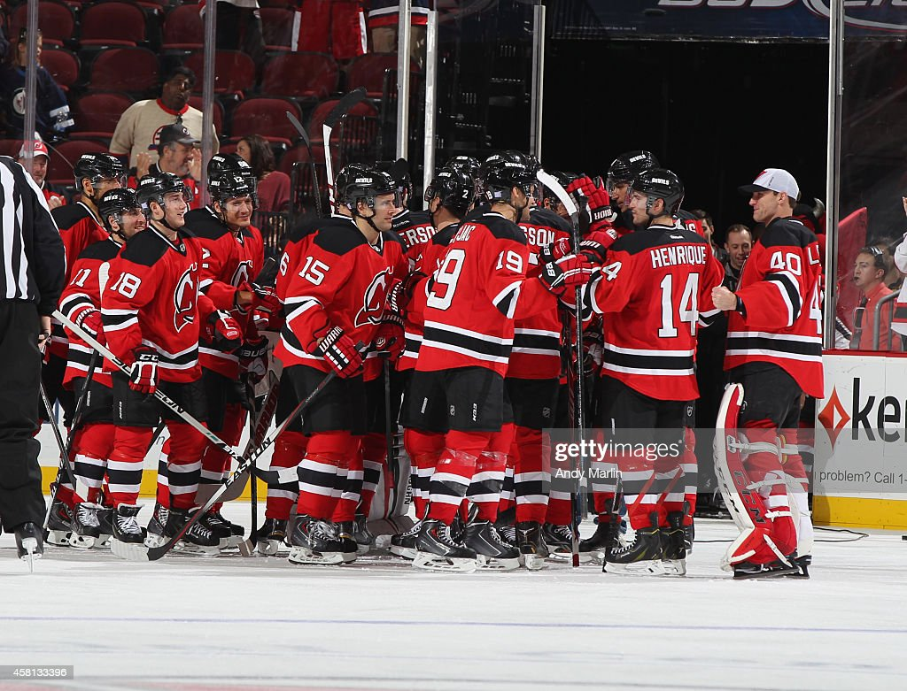 The New Jersey Devils celebrate after defeating the Winnipeg Jets in a shootout during the game at the Prudential Center on October 30, 2014 in Newark, New Jersey. The Devils defeated the Jets 2-1 in a shootout.