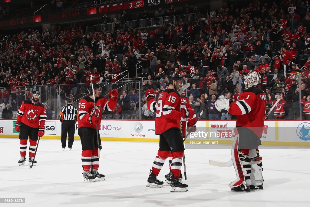 The New Jersey Devils celebrate their 4-3 victory over the Carolina Hurricanes at the Prudential Center on March 27, 2018 in Newark, New Jersey.