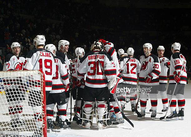 The New Jersey Devils celebrate their victory against the New York Islanders on March 27, 2007 at Nassau Coliseum in Uniondale, New York.