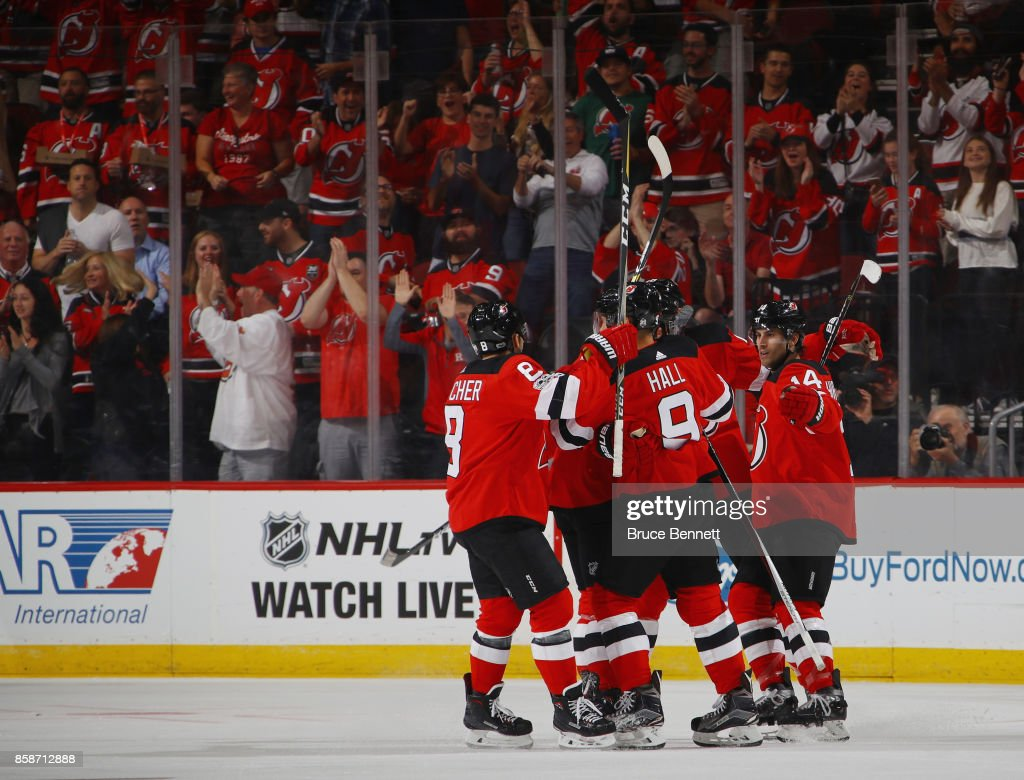The New Jersey Devils celebrates a first-period goal by Adam Henrique #14 (r) against the Colorado Avalanche at the Prudential Center on October 7, 2017 in Newark, New Jersey.
