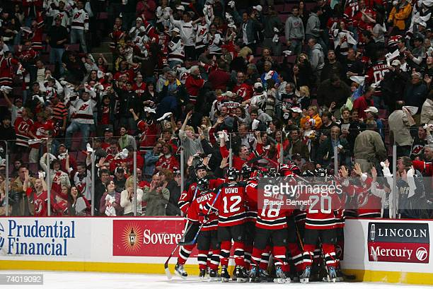 The New Jersey Devils celebrates the double overtime game winning goal of Jamie Langenbrunner that defeated the Ottawa Senators 32 to win Game 2 of...