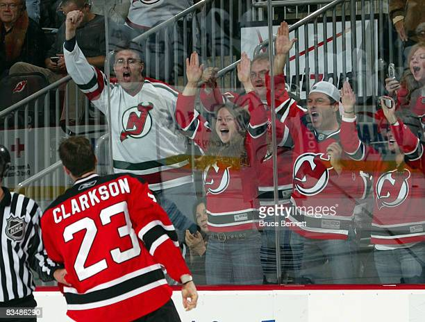 The New Jersey Devils fans cheer for David Clarkson after his fight against Jamal Mayers of the Toronto Maple Leafs on October 29 2008 at the...