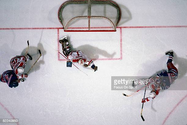 The New Jersey Devils' goalie Glenn Resch makes a save against the New York Rangers during a game at the Meadowlands Arena for the 198283 season in...