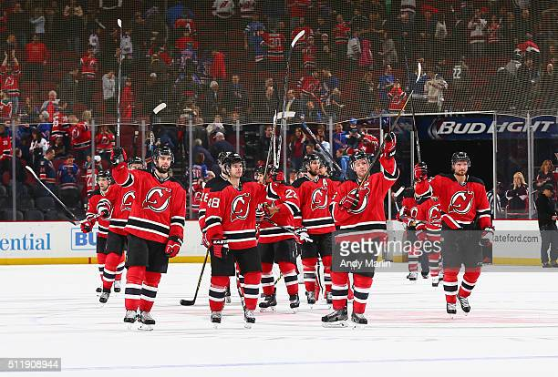 The New Jersey Devils salute their fans after defeating the New York Rangers at the Prudential Center on February 23 2016 in Newark New Jersey The...