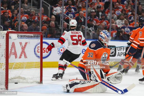 The New Jersey Devils score their fifth goal of the game on Edmonton Oilers Goalie Anthony Stolarz in the second period during the Edmonton Oilers...