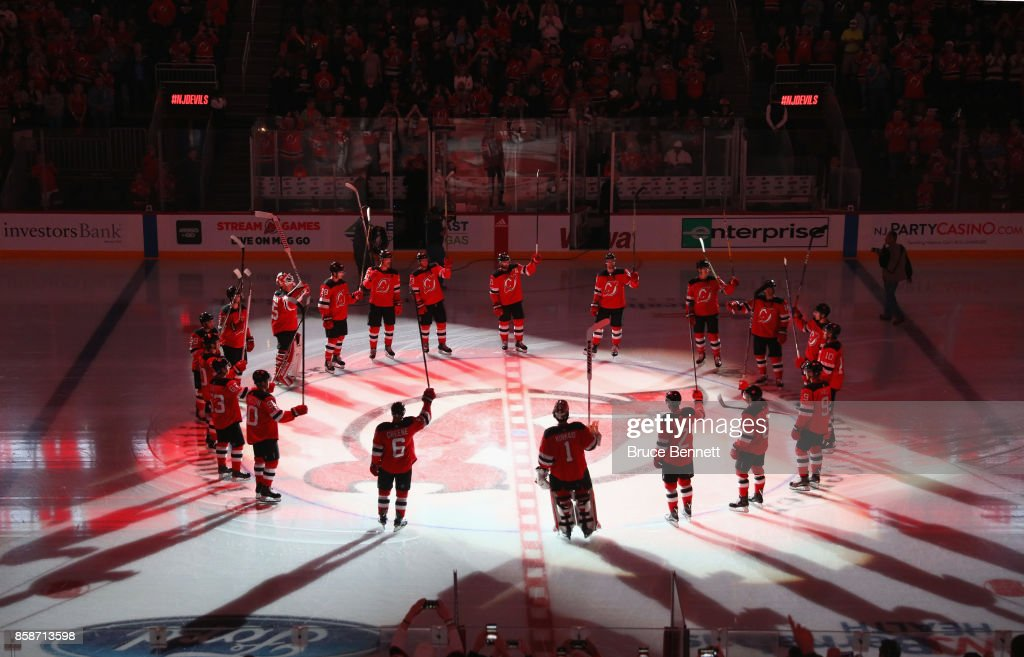 The New Jersey Devils take part in a season opening ceremony prior to their game against the Colorado Avalanche at the Prudential Center on October 7, 2017 in Newark, New Jersey.