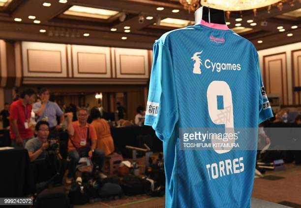 The new jersey for Spanish football star Fernando Torres is displayed during a press conference welcoming him to the JLeague club team Sagan Tosu in...