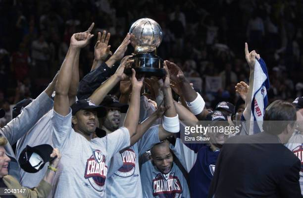 The New Jersey Nets celebrate with the Eastern Conference Championship Trophy after defeating the Detroit Pistons in Game Four of the Eastern...