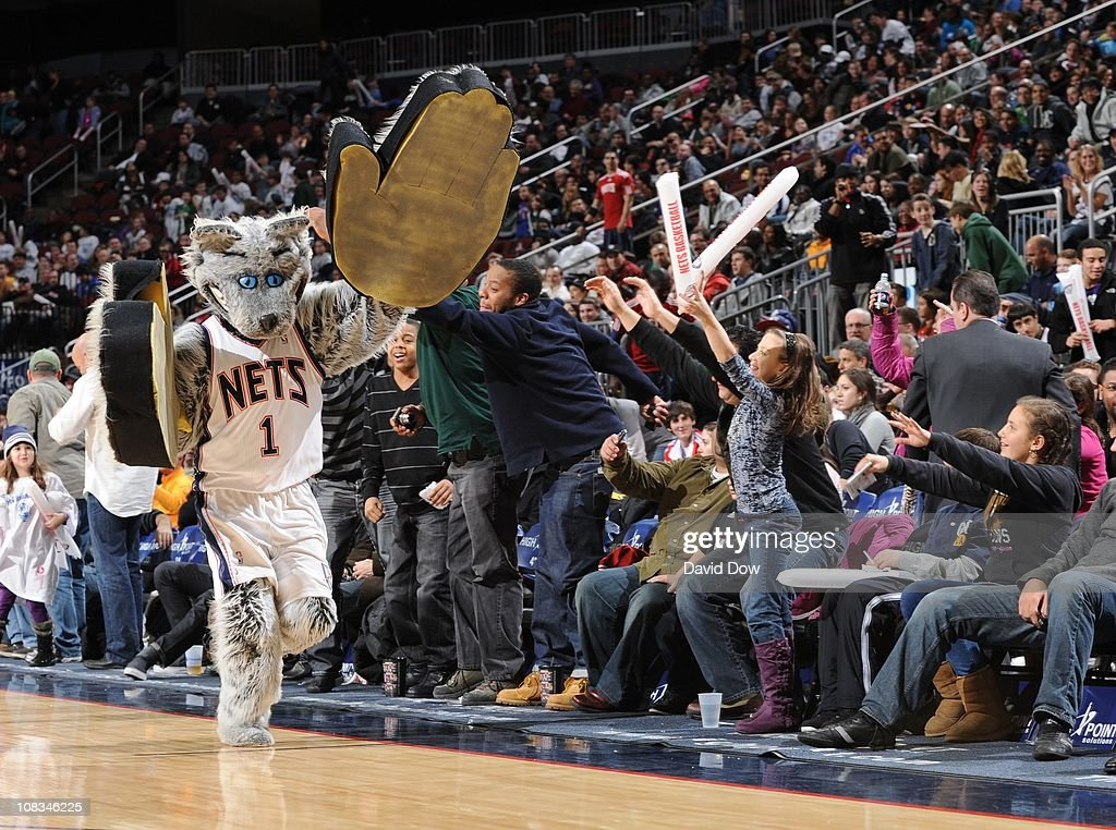 online store b1ad9 d76d3 The New Jersey Nets mascot runs the court during a game ...