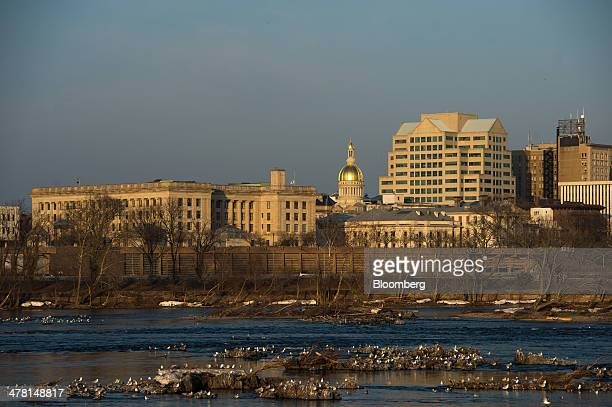 The New Jersey State House is seen from the Pennsylvania side of the Delaware River in Morrisville Pennsylvania US on Tuesday March 11 2014 New...