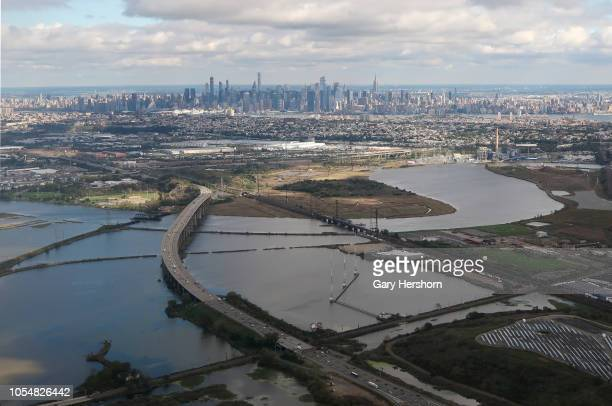 The New Jersey Turnpile makes its way to the Meadowlands Sports Complex in front of the skyline of midtown Manhattan in New York City on October 13...