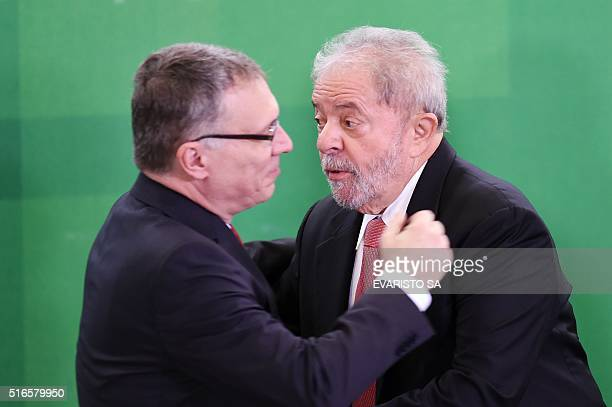 The new Justice Minister Eugenio Aragão hugs former president Luiz Inacio Lula da Silva during the swearingin ceremony at Planalto Palace in Brasilia...