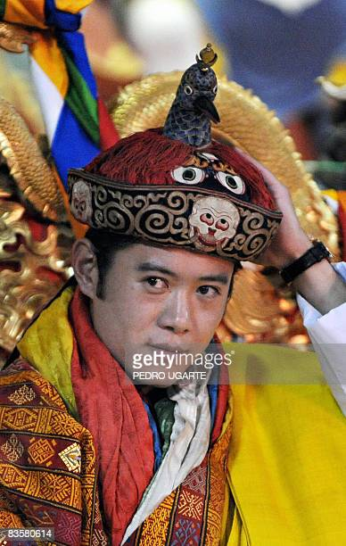 The new king of Bhutan Jigme Khesar Namgyel Wangchuck holds his crown at the Tashichho Dzong Palace in Thimphu on November 6 2008 The isolated...