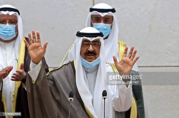The new Kuwaiti crown prince Sheikh Meshal al-Ahmad al-Jaber Al-Sabah waves as he arrives at the parliament to take oath on October 8, 2020. - Sheikh...
