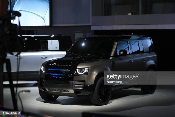 The new Land Rover Defender sports utility vehicle manufactured by Jaguar Land Rover Plc sits on display on the opening day of the IAA Frankfurt...