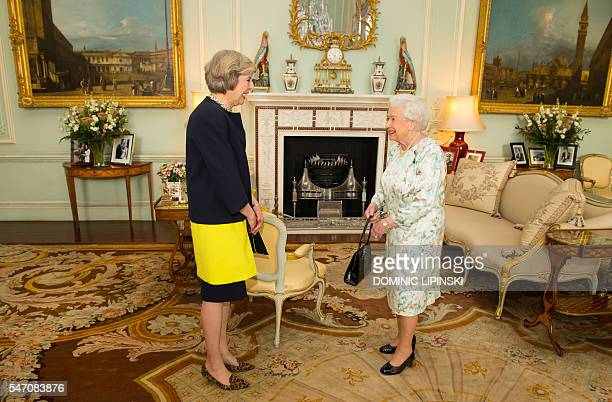 The new leader of the Conservative Party Theresa May is greeted by Britain's Queen Elizabeth II at the start of an audience in Buckingham Palace in...