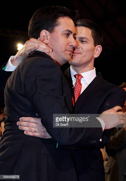 The new leader of the Labour Party Ed Miliband embraces his brother David after Ed was voted the new leader of the labour party at the annual Labour...