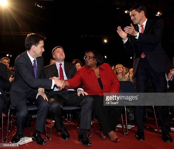 The new leader of the Labour Party Ed Miliband is congratulated by Diane Abbott before addressing the party faithful after the leadership...