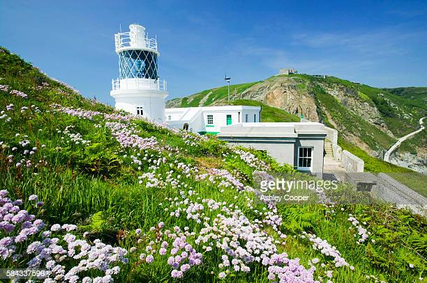 the new lighthouse on lundy island devon uk - island stock pictures, royalty-free photos & images