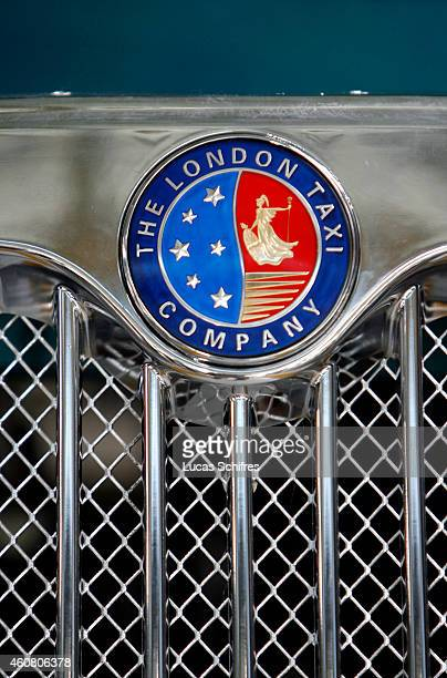 The new logo of London Taxi International hangs on a Taxi cab in the assembly line in SMA factory plant on October 24 2008 in Fengjing outside...