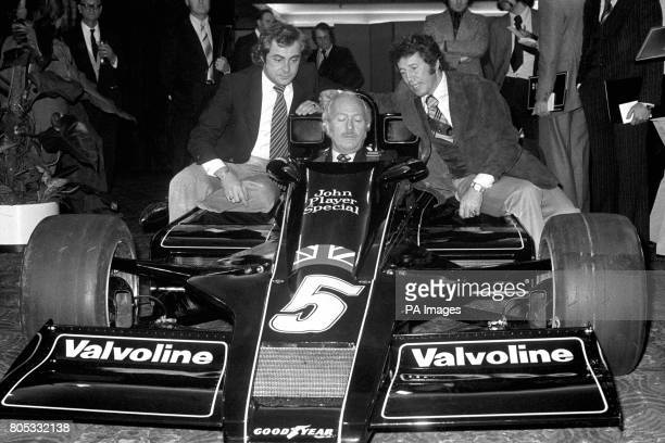 The new Lotus 78 is unveiled to the media during it's launch at London's Royal Garden Hotel Lotus chief Colin Chapman sits in the new car flanked by...