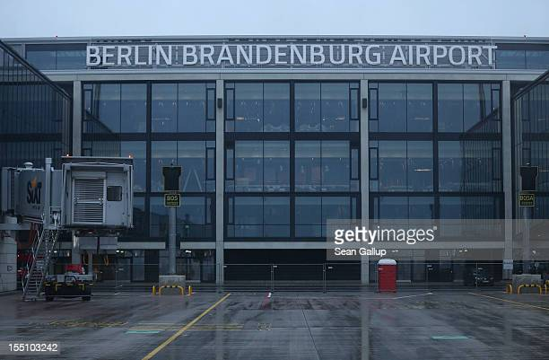 The new main terminal of the construction site of the new Willy Brandt Berlin Brandenburg International Airport stands under rainy weather on...