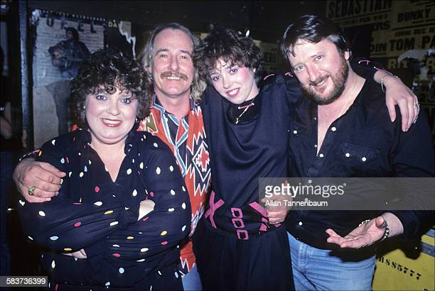 The New Mamas and Papas backstage at Paul Colby's The Other End on Bleecker Street in Greenwich Village New York New York March 3 1982 From left...