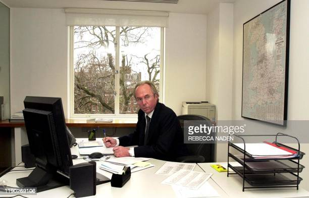 The new manager of England national soccer team Sweden's Sven Goran Eriksson is seated in his new office at FA Headquarters in Soho Square, in...