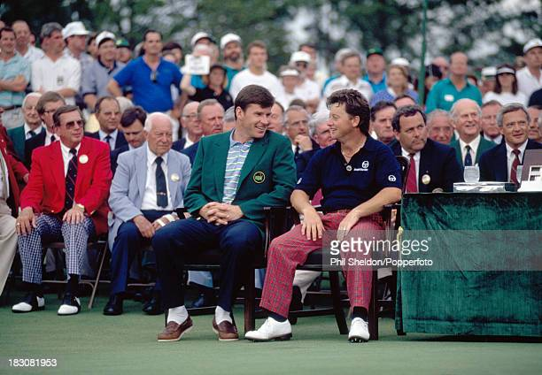 The new Masters Champion, Ian Woosnam of Great Britain and last year's winner Nick Faldo of Great Britain, chatting during the presentation ceremony...