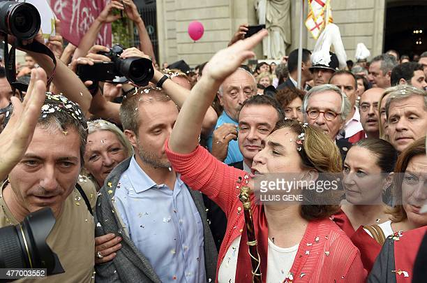 The new mayor of Barcelona Ada Colau waves to the people as she crosses Sant Jaume square to meet Catalonia's regional president at the Generalitat...