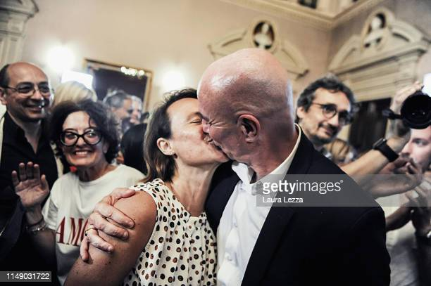 The new mayor of Livorno Luca Salvetti kisses his wife while celebrating the proclamation of victory in the ballot for the mayoral election on June...