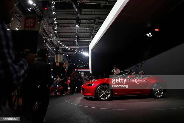 The new Mazda MX5 automobile produced by Mazda Motor Corp stands on display at the Paris Motor Show on the final preview day in Paris France on...
