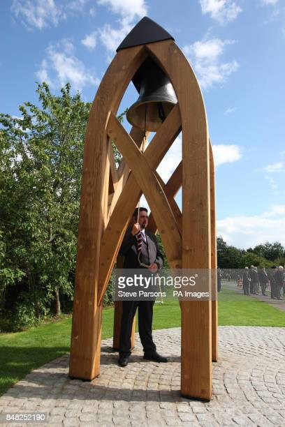 The new memorial bell in the Memorial Garden is rung as the friends and families of Guardsman Craig Roderick and Guardsman Apete Saunikalou...