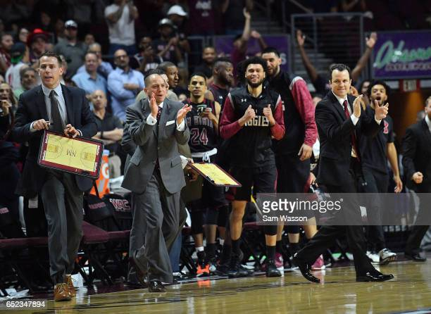The New Mexico State Aggies bench including head coach Paul Weir celebrate during the championship game of the Western Athletic Conference Basketball...