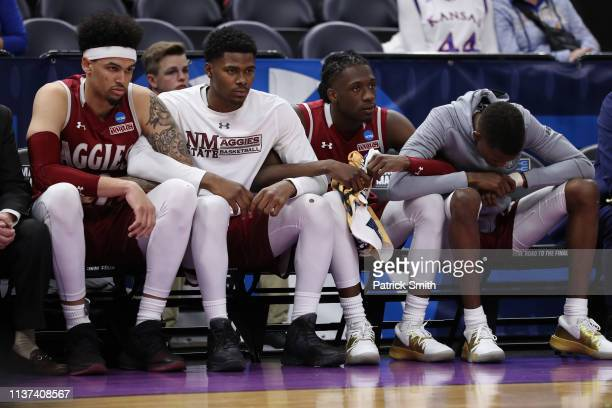 The New Mexico State Aggies bench reacts during the second half against the Auburn Tigers in the first round of the 2019 NCAA Men's Basketball...