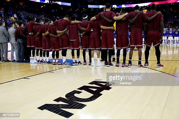 The New Mexico State Aggies line up prior to a game against the Kansas Jayhawks during the second round of the 2015 NCAA Men's Basketball Tournament...