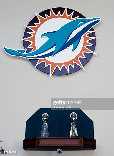 The new Miami Dolphins logo is displayed at the Miami Dolphins training facility above the two Vince Lombardi Super Bowl trophies prior to the...