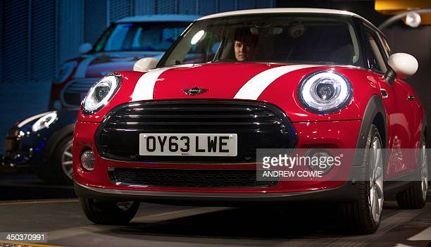 The new Mini Cooper car is pictured during its official unveiling at BMW's plant at Cowley in Oxford central England on November 18 2013 Car giant...
