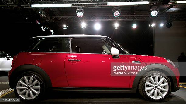 The new Mini Cooper is pictured following its official unveiling event at BMW's plant at Cowley in Oxford central England on November 18 2013 Car...