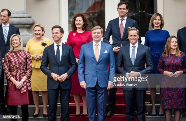 The new ministers and state secretaries of the cabinet Rutte III pose for a group photo with King Willem-Alexander and Prime Minister Mark Rutte at...